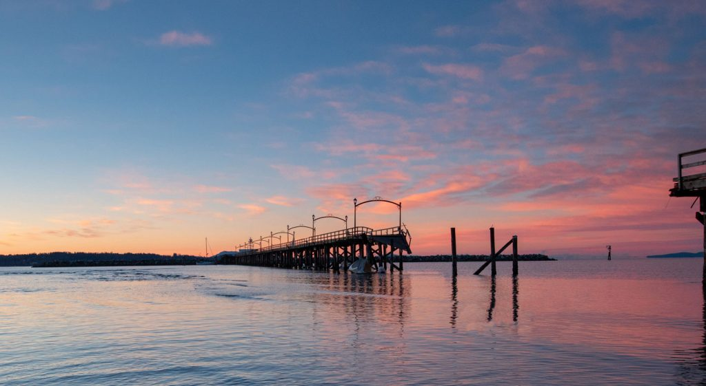 Sunset at the pier by White Rock Beach in White Rock BC Canada